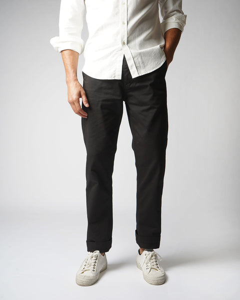black trousers model front