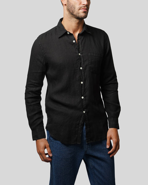 black linen long sleeve shirt model side