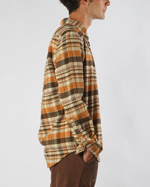 flannel shirt plaid orange brown model side
