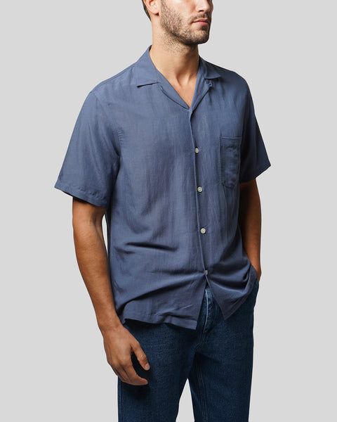 blue short sleeve shirt model side