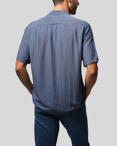 blue short sleeve shirt model back