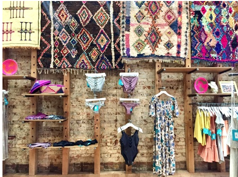 Trending now: vintage rugs in retail spaces!