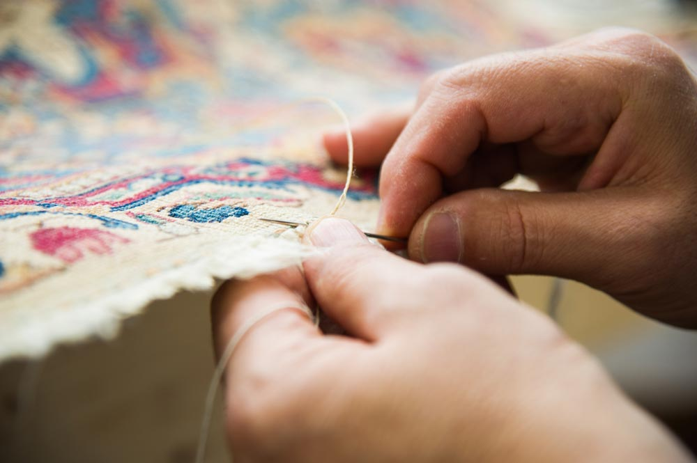 Rug repair by hand at Detroit Rug Restoration