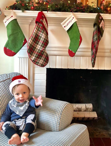 baby's first Christmas in front of fireplace