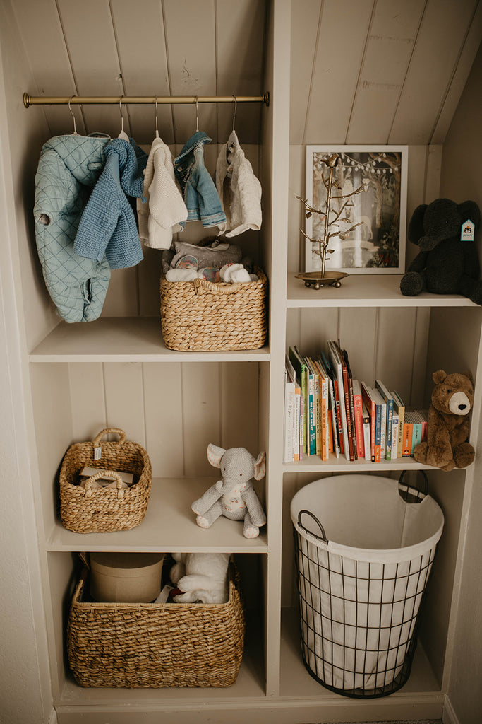 Cubbies for storage; hanging clothes, picture frame, toy bin, shelf for books, and laundry basket