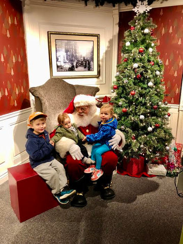 kids visiting santa holiday tradition