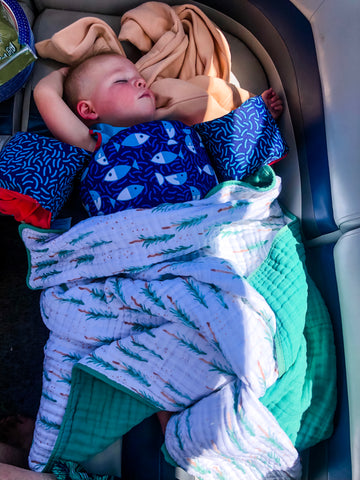 nap time with toddler on boat Parker baby quilt