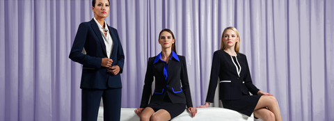 Three professional women in dark suits