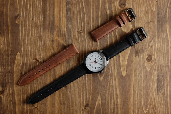 Genuine leather straps are available in black and natural brown