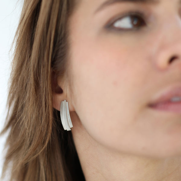 closeup of guggenheim earrings on girl