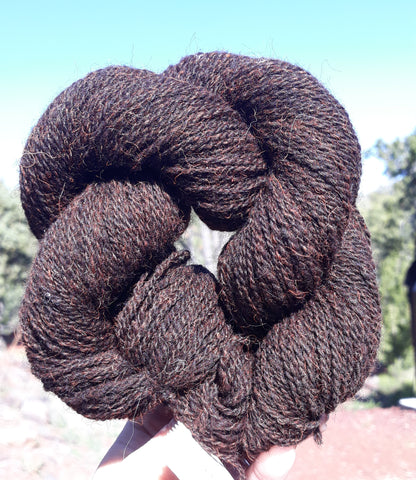 2 ply Sport. 100% black wool dyed orange