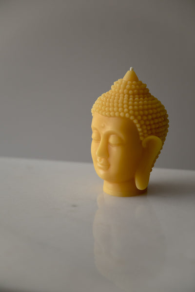Buddha in pure beeswax form. A Candle made of only pure Canadian beeswax.
