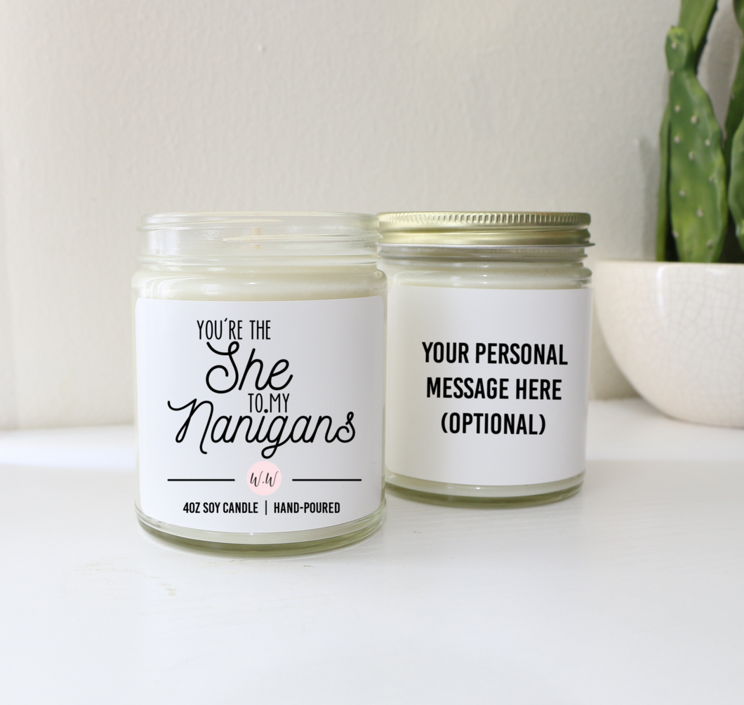 You're the she to my nanigans soy wax candle in glass jar with gold lid. Personalized message optional.