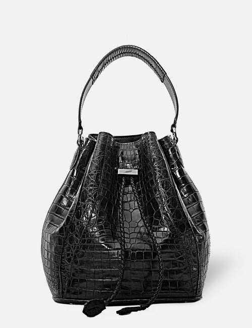 Khirma New York Unique Luxury Designer Exotic Crocodile Skin Edem Bucket Bag in Black. Removable cross body strap.