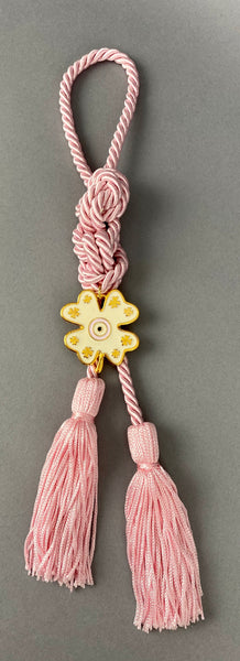 "Gouri 1023 Pearl Pink  Cord Gouri, metal 4 leaf clover with Mati and double tassel.   Measures 13"" in length."