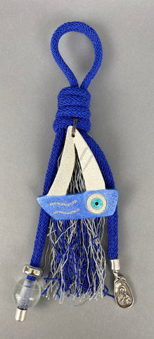 "Gouri 1021 Navy Blue Cord Gouri, large Cerac Mati Sailboat, large  Murano Glass Bead with metal double sided Panagia and Ag. Christoforos.   Measures 13"" in length."