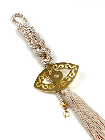 Large Polished Metal Evil Eye Gouri on Champagne Double Corded Braid with Long Tassel