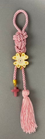"Gouri 1022 Pearl Pink  Cord Gouri, metal 4 leaf clover with Mati, glass cross with tassel.   Measures 13"" in length."