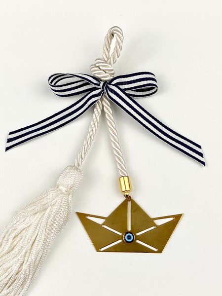 Polished Metal Sail Boat with Evil Eye Bead on White  rope with tassel