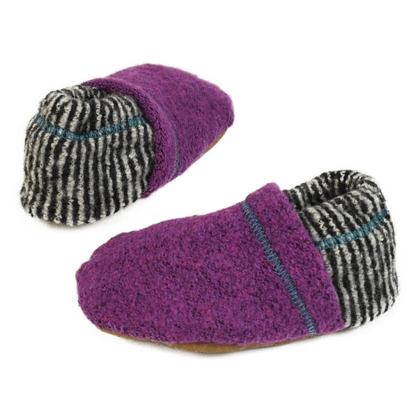 purple soft baby booties with black and white stripe with contrasting stitching.