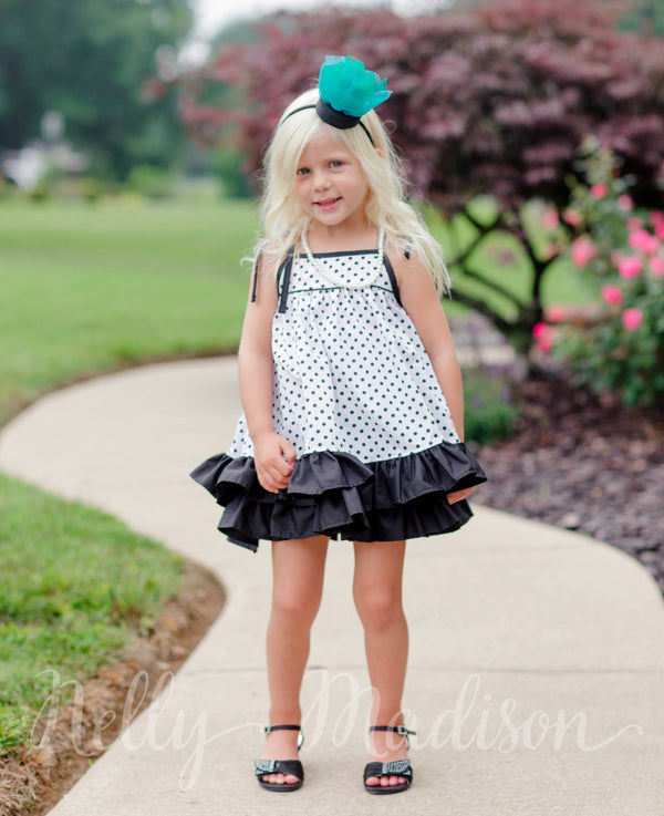 black and white polka dot girls dress with ruffles