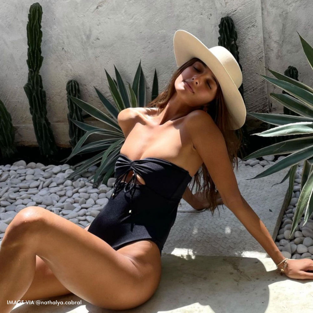 Nathalya Cabral wearing the maxim one piece swimsuit on a beach