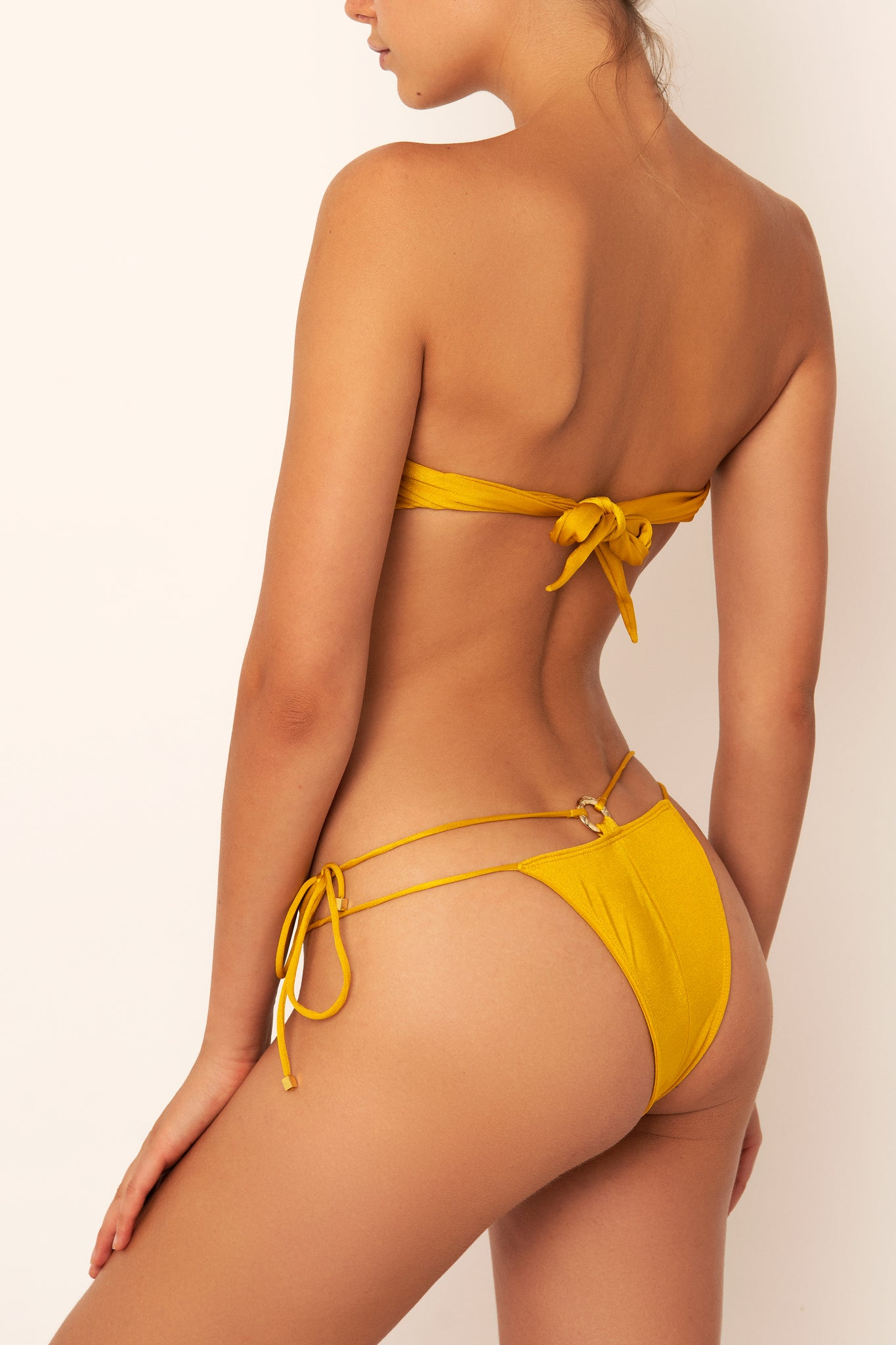 bikini bottom in yellow mustard on body side view on site