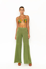Sommer Swim model facing forward and wearing Calvi Lounge pant in Chartreuse