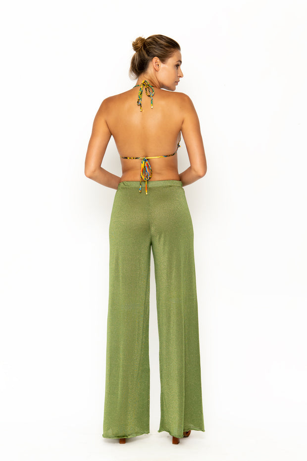 Sommer Swim model facing backwards and wearing Calvi Lounge pant in Campari