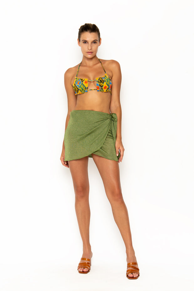 Sommer Swim model facing forwards and wearing Salinas mini wrap skirt in Chartreuse