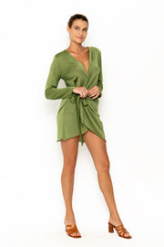 Sommer Swim model facing forward to the right and wearing Madeira Wrap dress in Campari