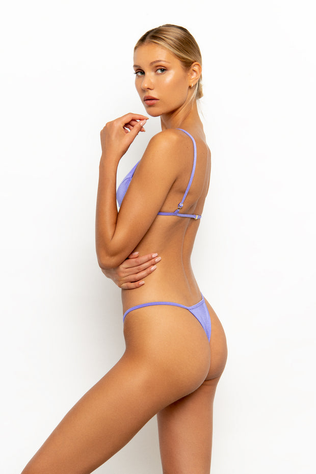 Side view of Sommer Swim model wearing the Uma Bralette Bikini Top in colour-way Provenza and matching bottoms