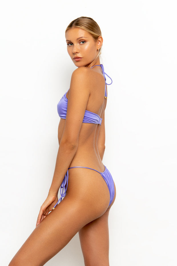 Sommer Swim model standing sideways wearing the Xena Halter Style Bikini Top in colour-way Provenza