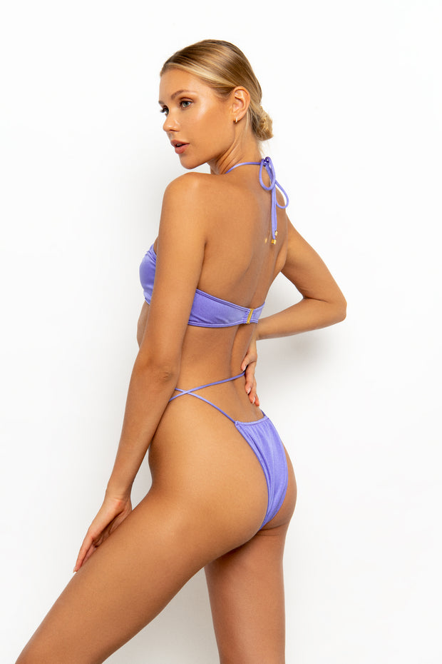 Sommer Swim model standing sideways wearing the Naomi Tie Side Brazilian Bikini Bottoms in colour-way Provenza