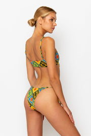 Sommer Swim model facing backwards and wearing a Cara brazilian bikini bottom in Baroque