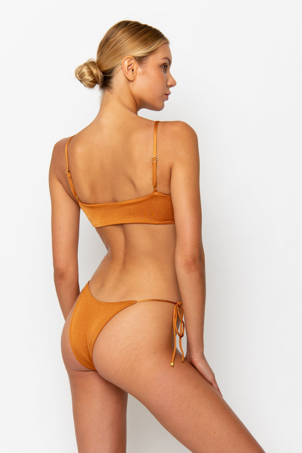 Sommer Swim model facing backwards and wearing a Cara brazilian bikini bottom in Papagayo