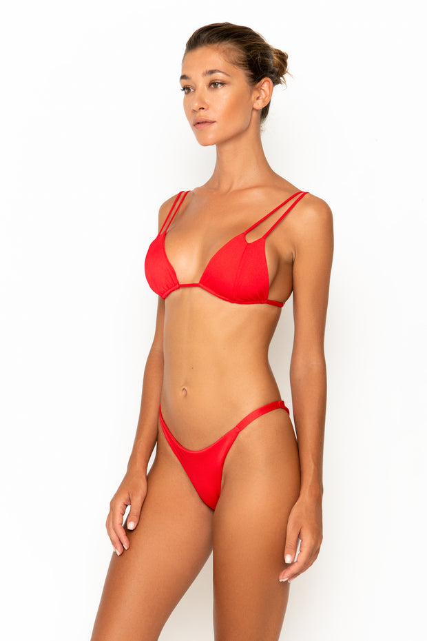 Sommer Swim model facing sideways to the right and wearing Daria bralette bikini top in Venere