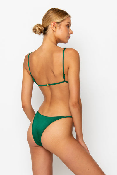 Sommer Swim model facing backwards and is wearing a Eden cheeky bikini bottom in Emerald