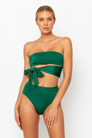 Sommer Swim Model facing forwards and wearing a Harlow bandeau bikini top in Emerald