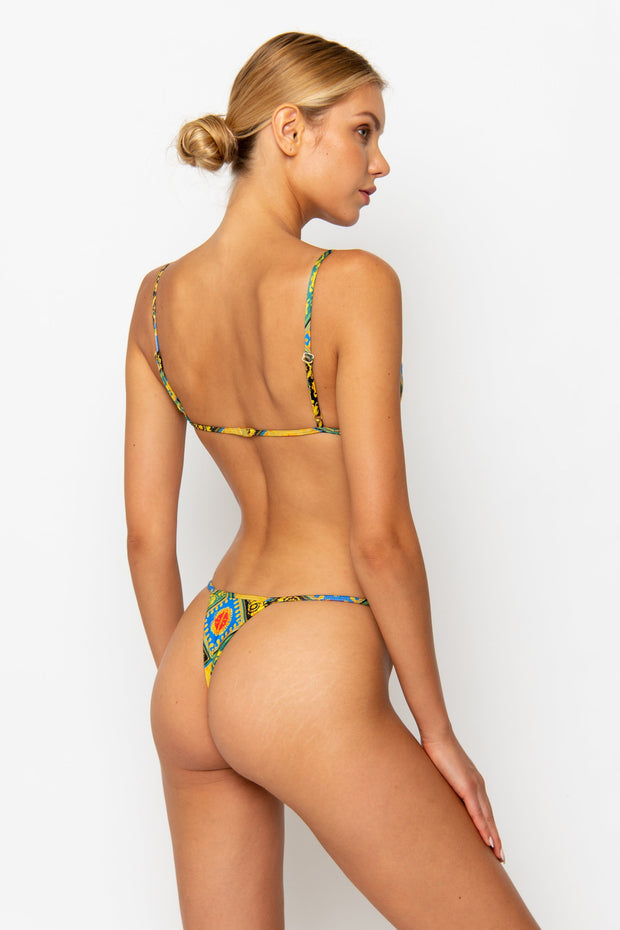 Sommer Swim model facing backwards and wearing a Jane thong bottom in Baroque