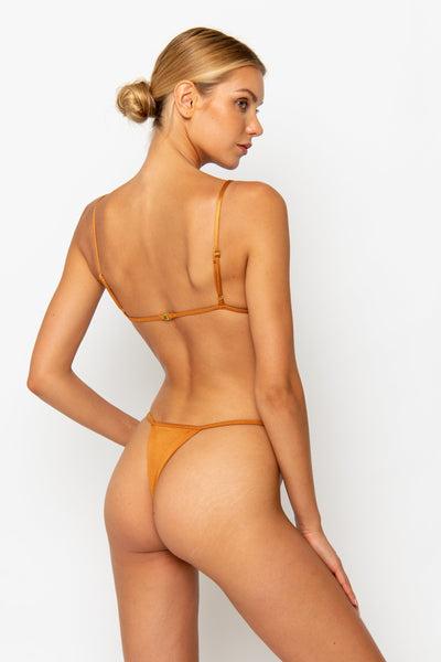 Sommer Swim model facing backwards and wearing a Jane thong bikini bottom in Papagayo