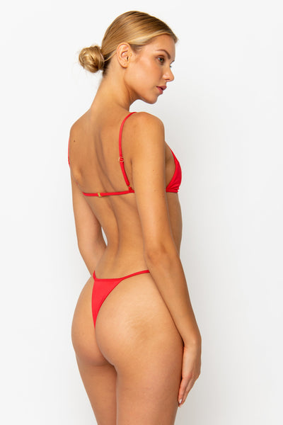 Sommer Swim model facing backwards and wearing a Jane thong bikini bottom in Venere