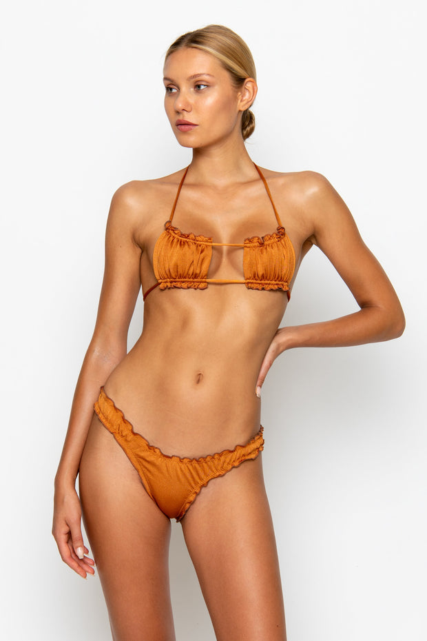 Sommer Swim model facing forwards and wearing a Josephine brazilian bikini bottom in Papagayo
