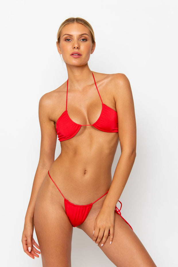 Sommer Swim model facing forwards and wearing a Naomi tie side bikini bottom in Venere