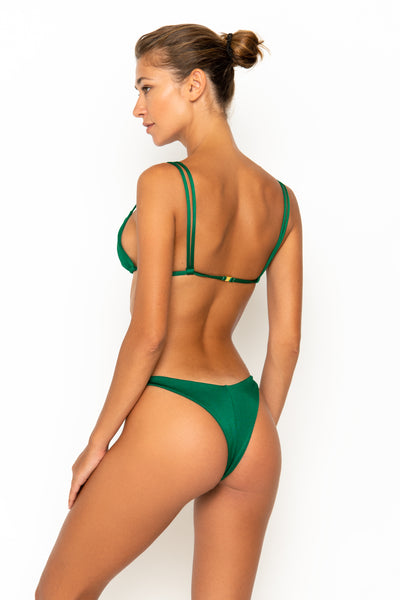 Sommer Swim model facing backwards and wearing Rocha cheeky bikini bottoms in Emerald