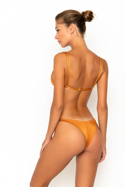Sommer Swim model facing backwards and wearing Rocha cheeky bikini bottoms in Papagayo