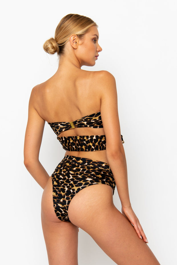 Sommer Swim model facing backwards and wearing a Sienna high waisted bottom in Leopard Luxe