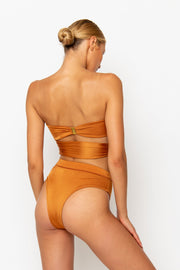 Sommer Swim model facing backwards and wearing a Sienna high waisted bikini bottom in Papagayo