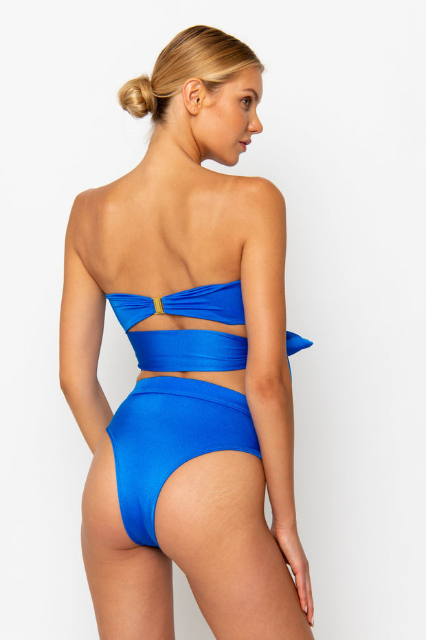 Sommer Swim model facing backwards and wearing a Sienna high waisted bikini bottom in Sirius