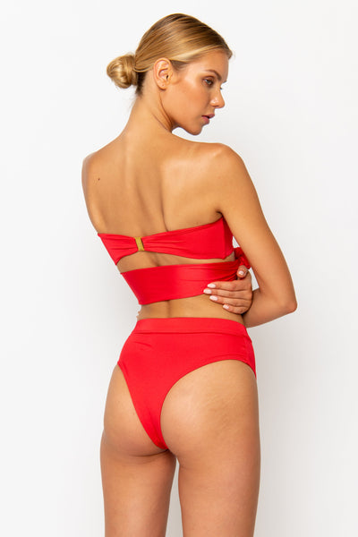 Sommer Swim model facing backwards and wearing a Sienna high waisted bikini bottom in Venere